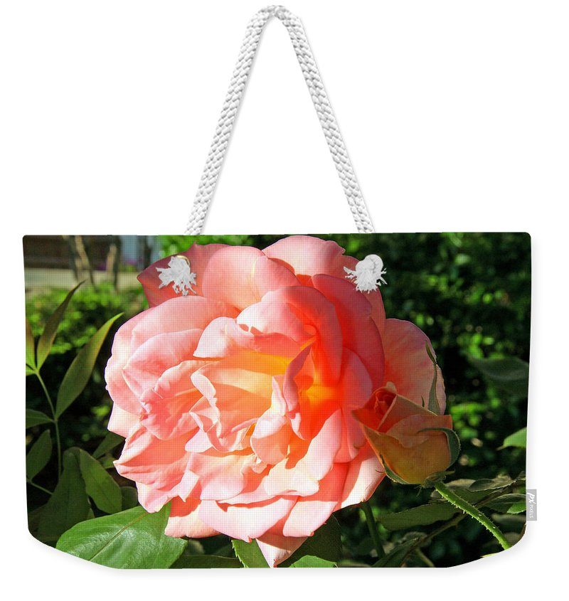 Rose Weekender Tote Bag featuring the photograph A Rose And A Rose by Cora Wandel