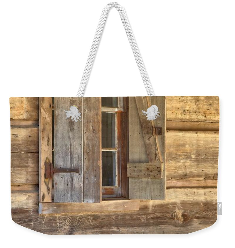 8195 Weekender Tote Bag featuring the photograph A Seat By The Window by Gordon Elwell