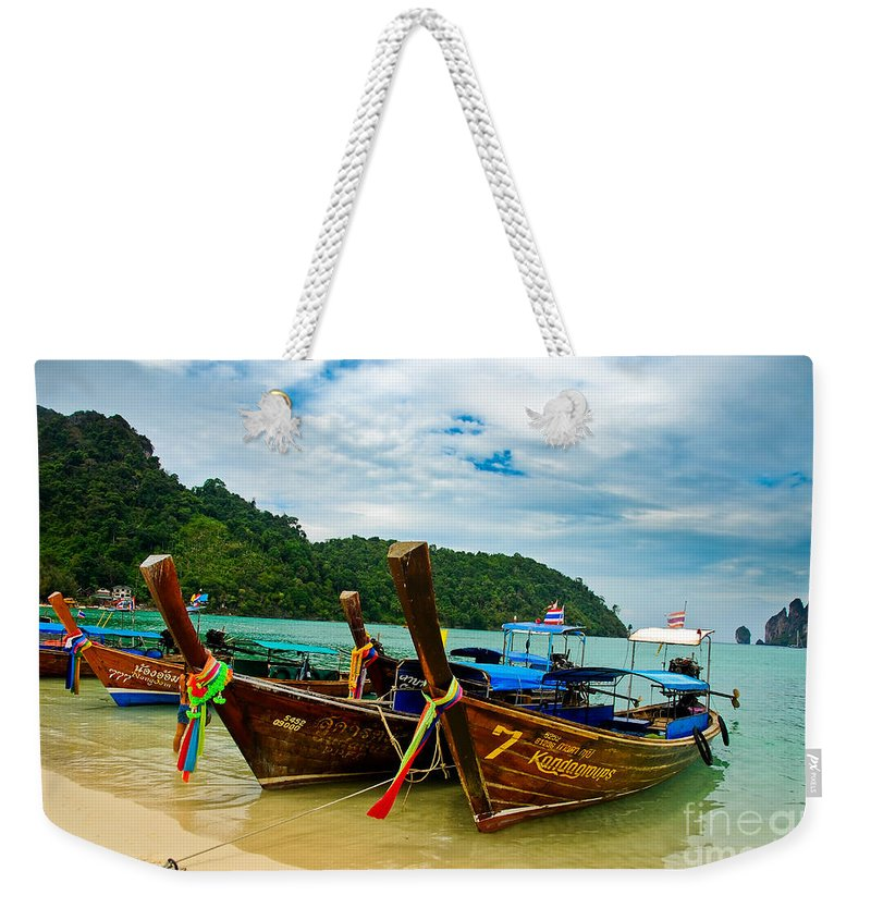 Long Tail Weekender Tote Bag featuring the photograph A Series Of Long Tails by Syed Aqueel