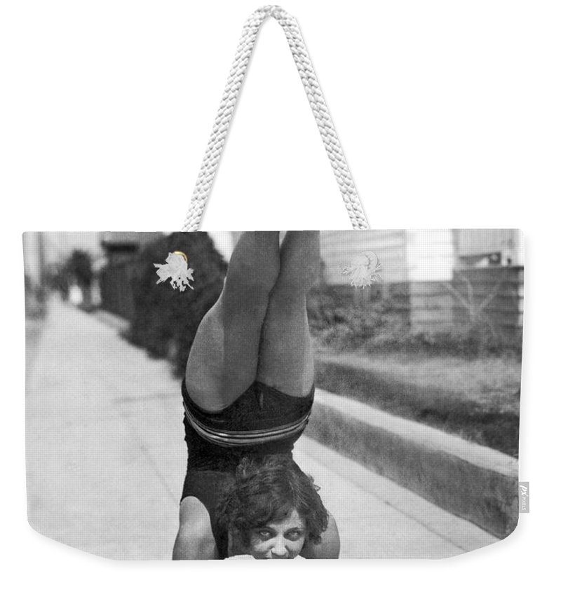 1927 Weekender Tote Bag featuring the photograph California Girl Imbibes Soda Upside Down by Underwood Archives