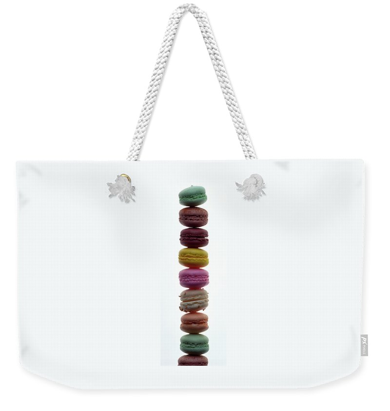 Cooking Weekender Tote Bag featuring the photograph A Stack Of Macaroons by Romulo Yanes