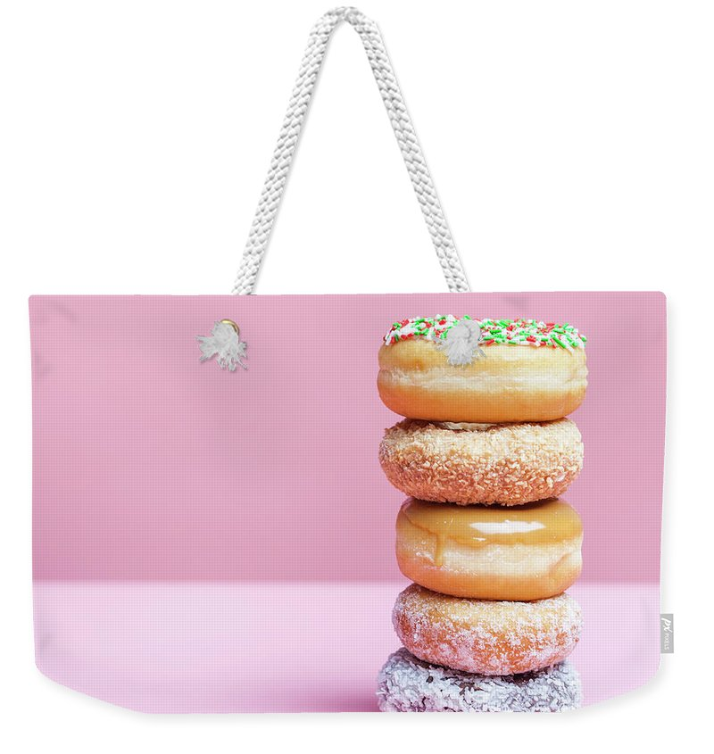 Five Objects Weekender Tote Bag featuring the photograph A Stack Of Various Donuts by Steven Errico