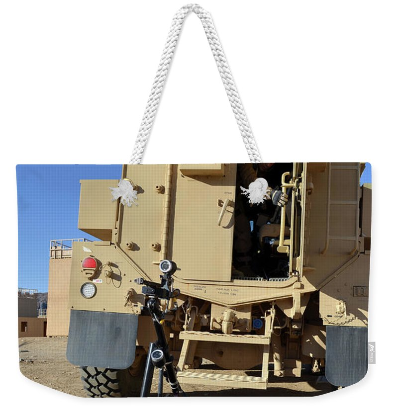 Military Weekender Tote Bag featuring the photograph A Talon Mark 2 Bomb Disposal Robot by Stocktrek Images