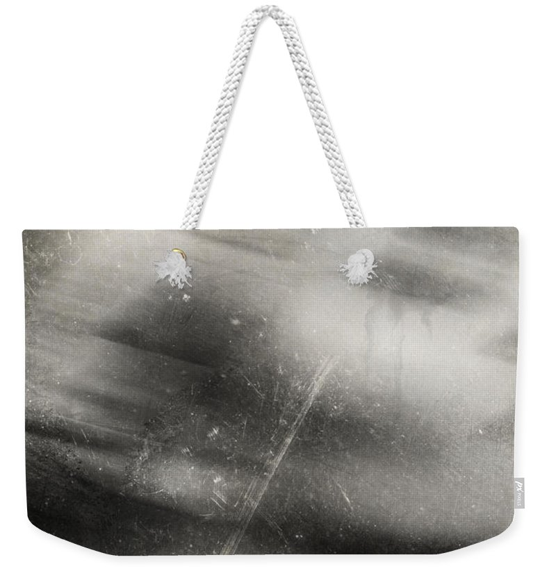 Tear Weekender Tote Bag featuring the photograph A Tear For Heaven by The Artist Project