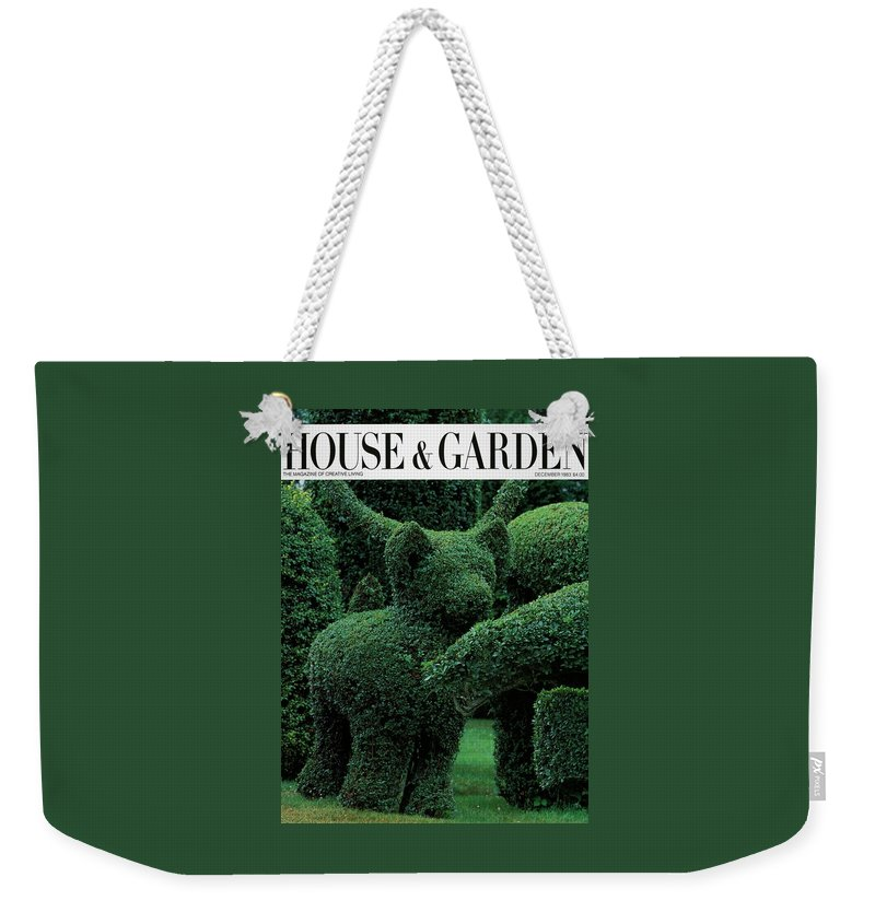 Animal Weekender Tote Bag featuring the photograph A Topiary Bear In Alice Braytons Green Animals by Horst P. Horst