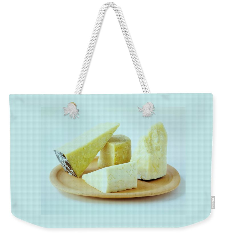 Dairy Weekender Tote Bag featuring the photograph A Variety Of Cheese On A Plate by Romulo Yanes