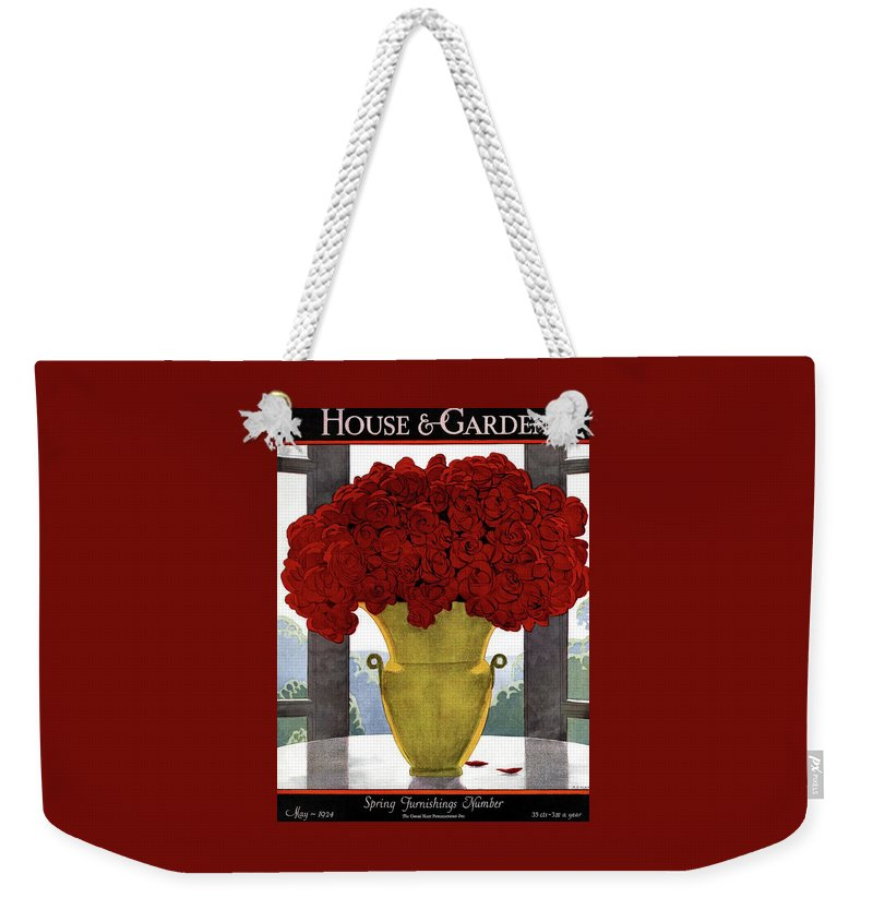 House And Garden Weekender Tote Bag featuring the photograph A Vase With Red Roses by Andre E Marty
