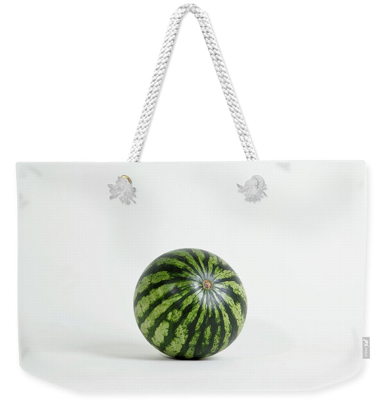 Shadow Weekender Tote Bag featuring the photograph A Whole Ripe Watermelon, Studio Shot by Halfdark