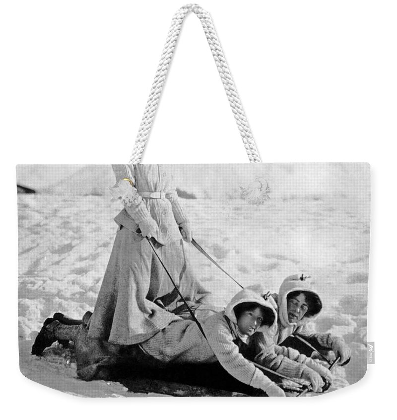 1900 Weekender Tote Bag featuring the photograph A Woman Rides On Two Friends by Underwood Archives