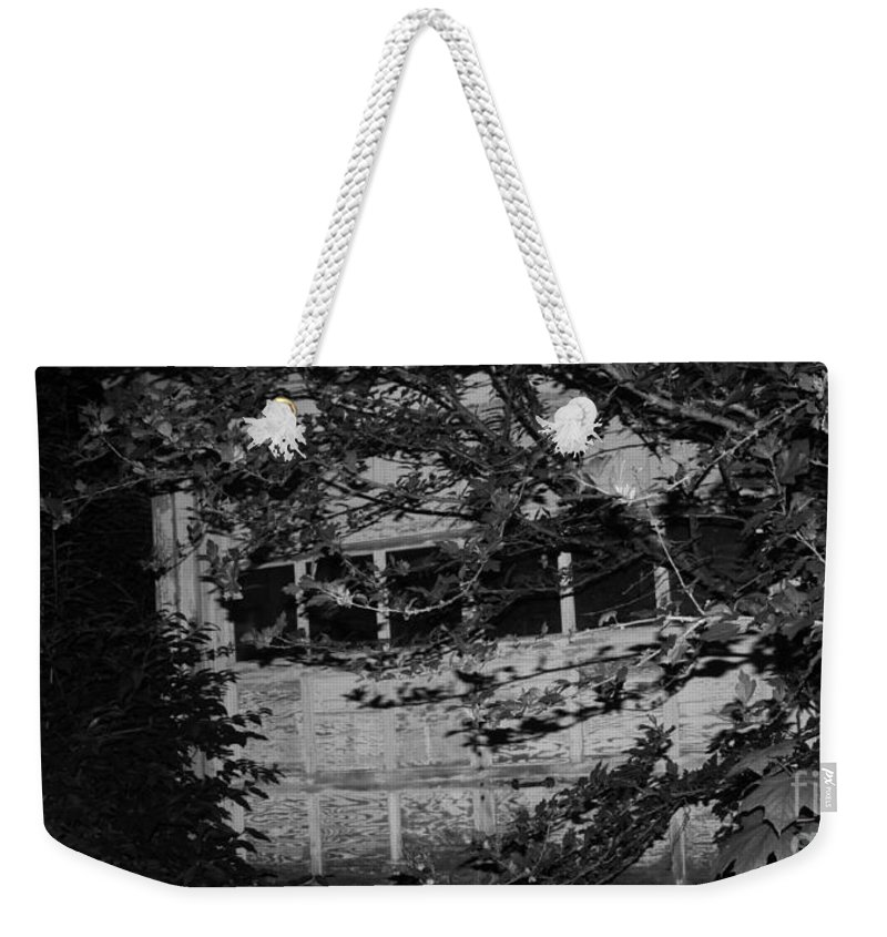 Abandoned And Forgotten Behind Trees Weekender Tote Bag featuring the photograph Abandoned And Forgotten Behind Trees by John Telfer
