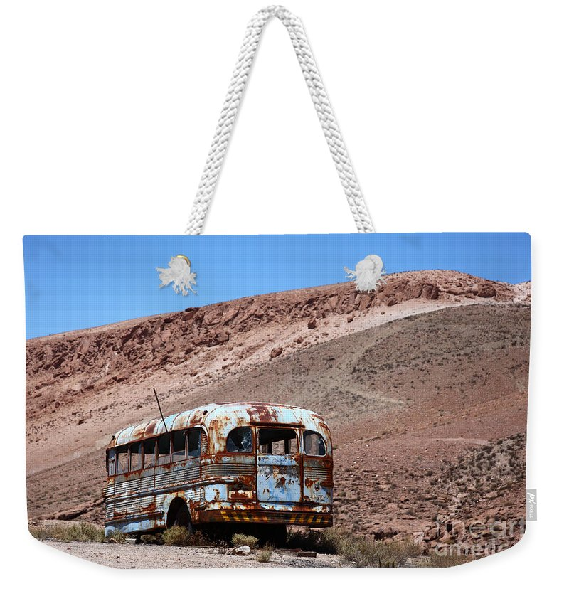 Rust Weekender Tote Bag featuring the photograph Abandoned Bus In The Atacama Desert by James Brunker