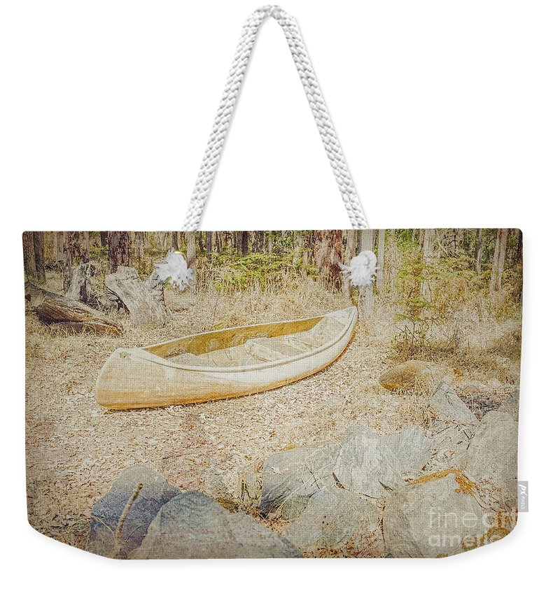 Canoe Weekender Tote Bag featuring the photograph Abandoned by Elaine Teague