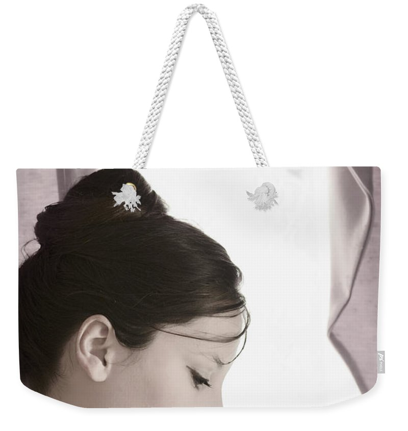 Woman; Female; Lady; Caucasian; Beautiful; Pretty; Brunette; Up Do; Dress; Elegant; Formal; Face; In Thought; Pearls; Indoors; Inside; Drapes; Audrey Hepburn; Pose; Pink; Soft; Softness; Ballerina; Sad; Lonely; Ballet; On Stage; Looking Down; Eyes Closed Weekender Tote Bag featuring the photograph About To Go On Stage by Margie Hurwich