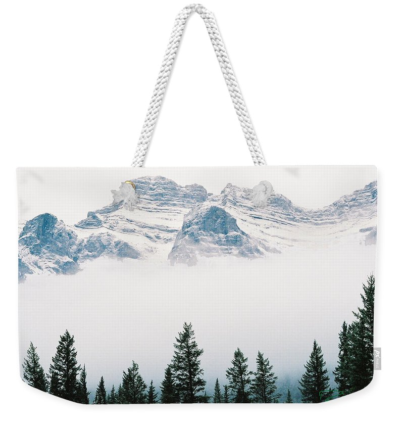 Canadian Rockies Weekender Tote Bag featuring the photograph Above The Fog by Rodney Troch