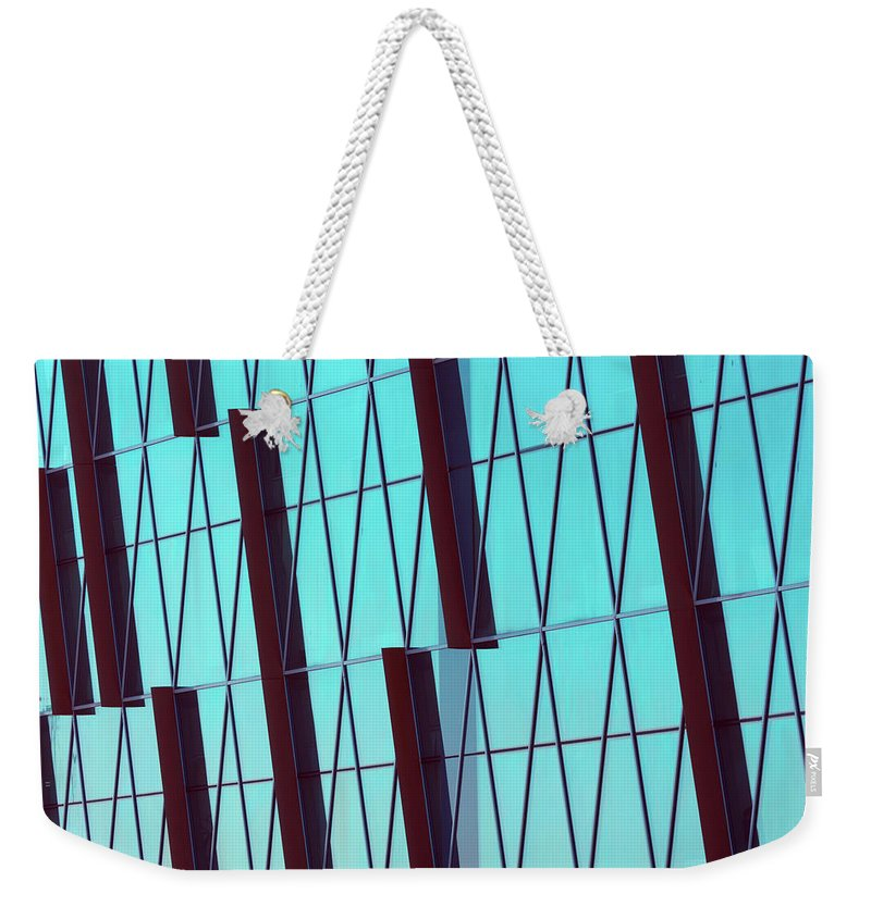 Ceiling Weekender Tote Bag featuring the photograph Abstract Glass Surface With Geometric by Aapsky