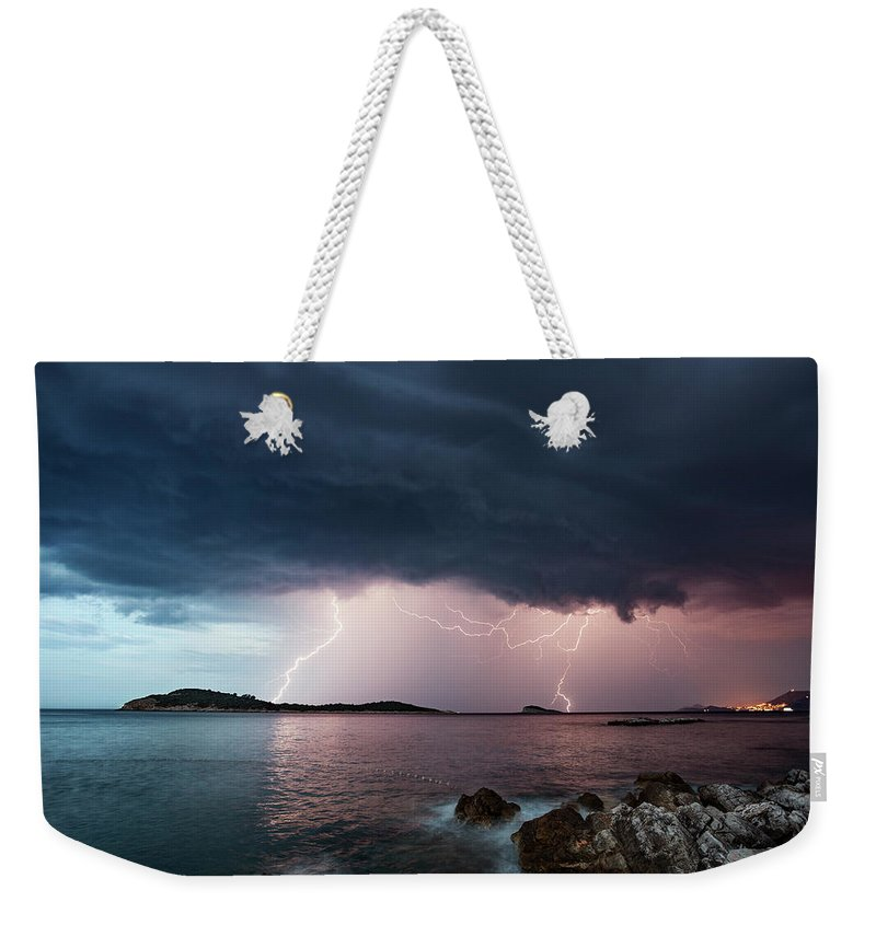 Adriatic Sea Weekender Tote Bag featuring the photograph Adriatic Lightning by Image By Chris Winsor