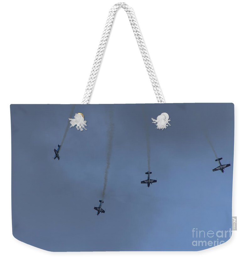 Blades Aerobatic Team Weekender Tote Bag featuring the photograph Aerobatic Planes by Brian Roscorla
