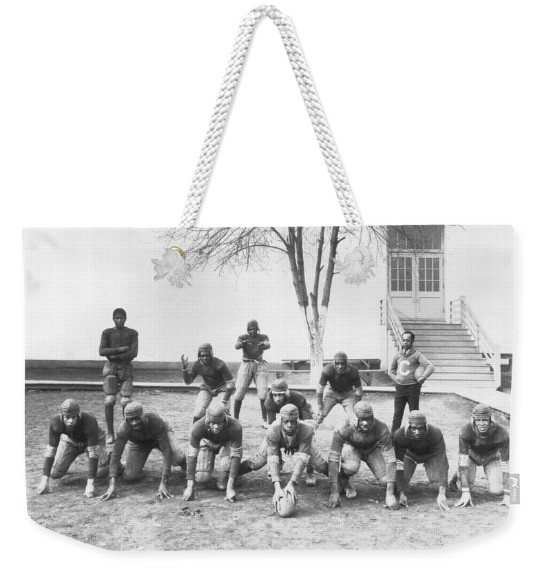 1921 Weekender Tote Bag featuring the photograph African American Football Team by Underwood Archives