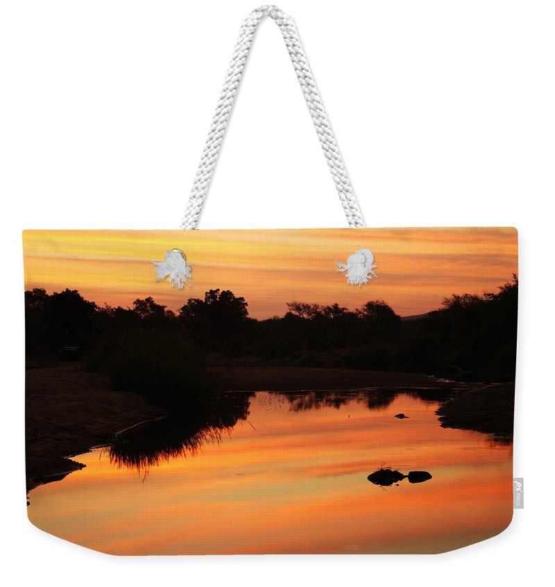 South Africa Weekender Tote Bag featuring the photograph African Sunset by Laura Earl