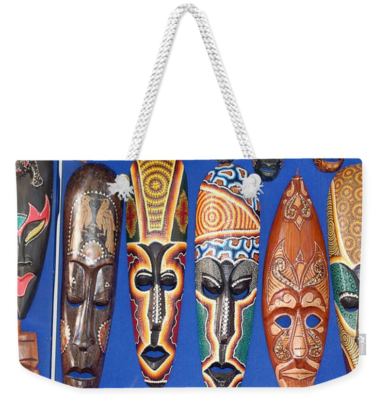 African Tribal Masks Weekender Tote Bag featuring the digital art African Tribal Masks In Sidi Bou Said by Eva Kaufman