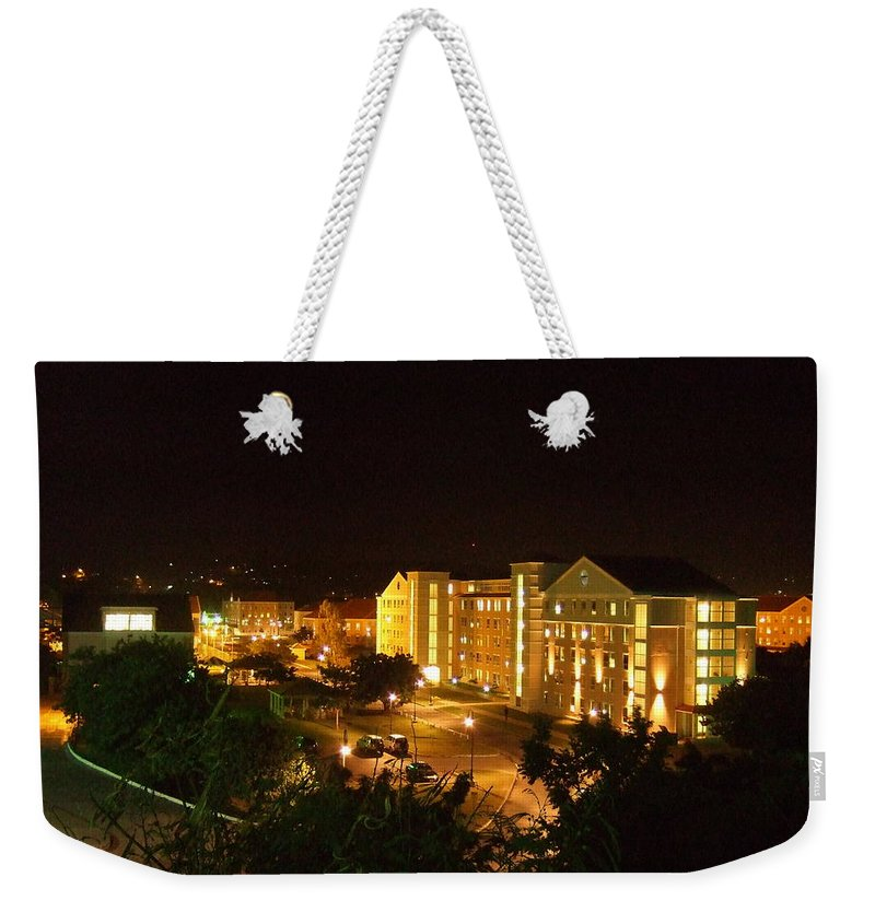 Weekender Tote Bag featuring the photograph After Dark by Katerina Naumenko