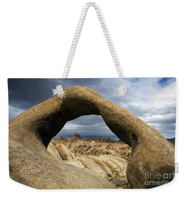 Travel Weekender Tote Bag featuring the photograph Alabama Hills Arch by Jason O Watson