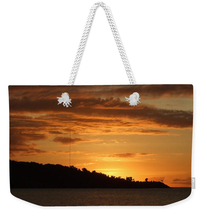 Weekender Tote Bag featuring the photograph Alight With The Sun by Katerina Naumenko
