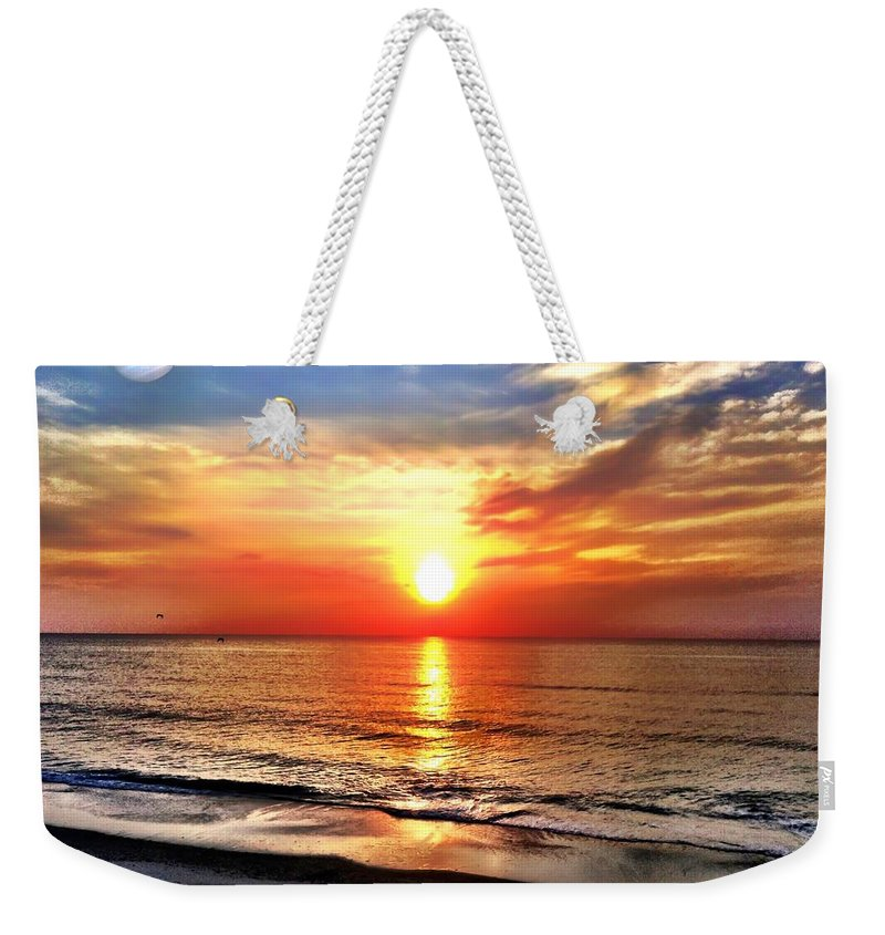 Jupiter Weekender Tote Bag featuring the photograph Alignment by Carlos Avila