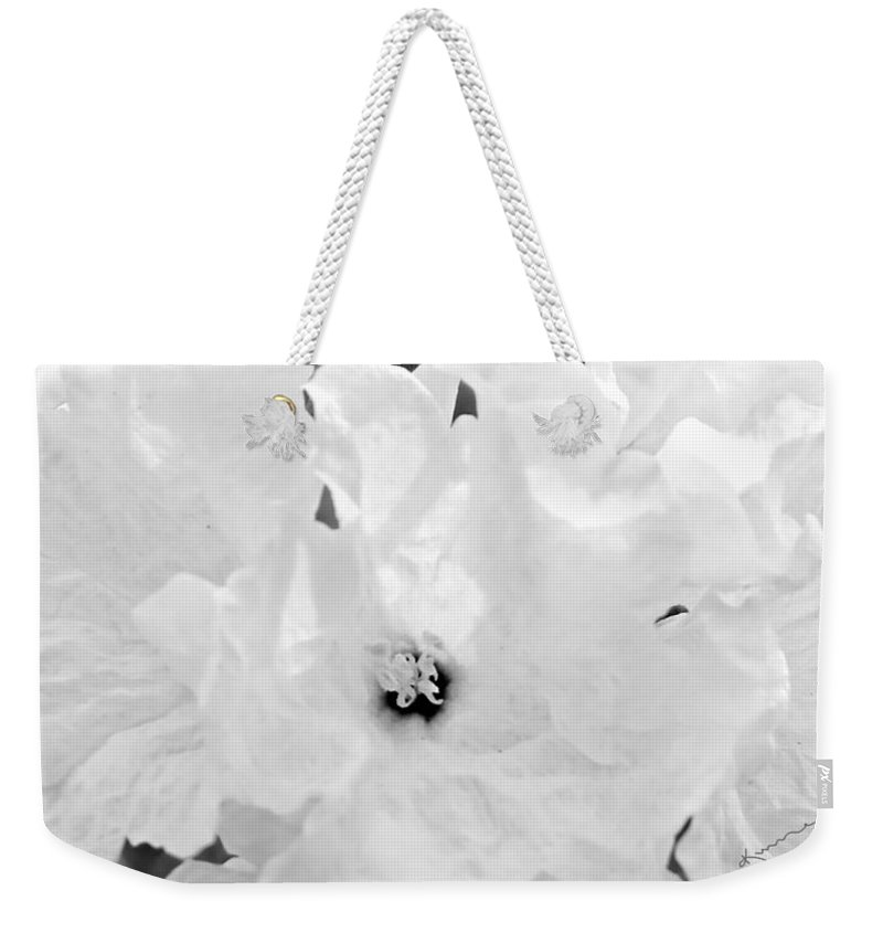White Flower Weekender Tote Bag featuring the photograph All In White by Kume Bryant