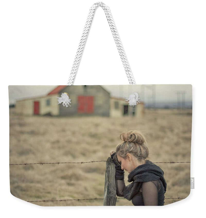 Woman Weekender Tote Bag featuring the photograph All That's Left Behind by Evelina Kremsdorf