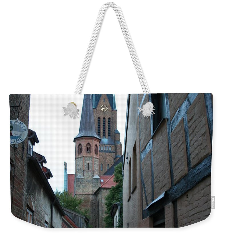 Alley Weekender Tote Bag featuring the photograph Alley In Schleswig - Germany by Christiane Schulze Art And Photography