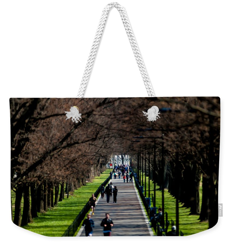Alley Weekender Tote Bag featuring the photograph Alley Of Trees With Runners And Joggers by Alex Grichenko