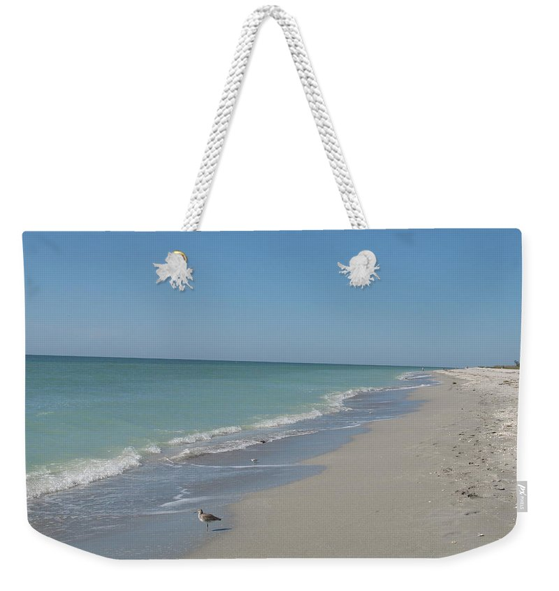 Beach Weekender Tote Bag featuring the photograph Alone At The Beach by Christiane Schulze Art And Photography