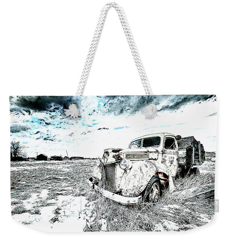 Car Weekender Tote Bag featuring the photograph Alone by Lyriel Lyra