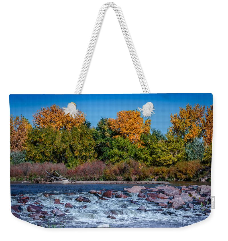 Creek Weekender Tote Bag featuring the photograph Along The Creek by Ernie Echols