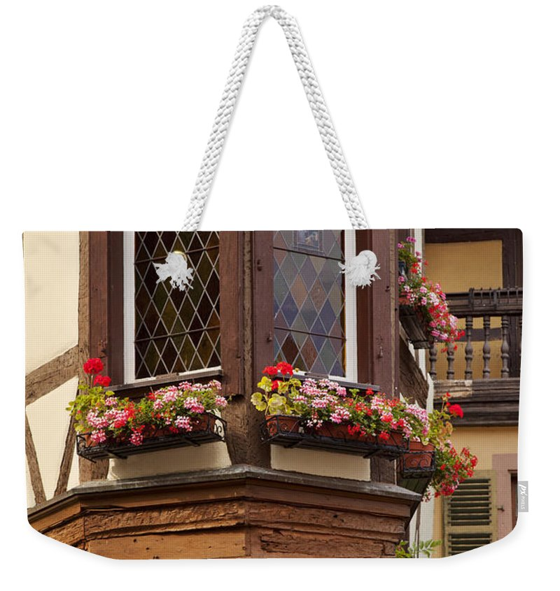 Kaysersberg Weekender Tote Bag featuring the photograph Alsace Window by Brian Jannsen