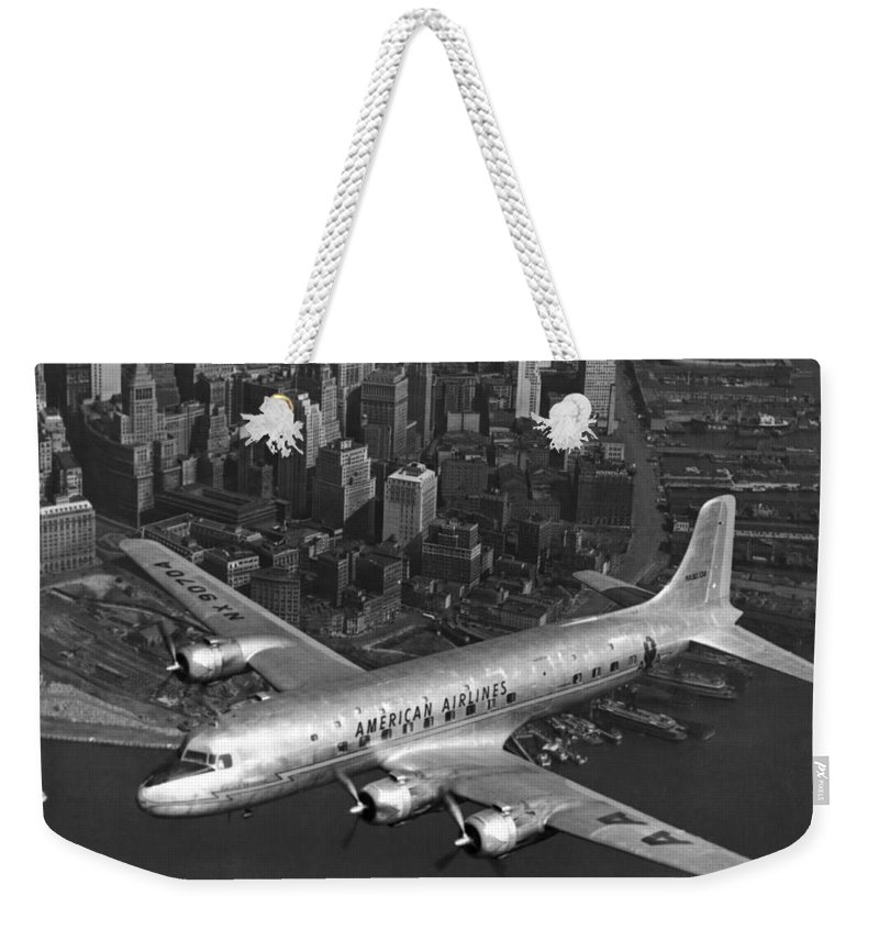 1035-207 Weekender Tote Bag featuring the photograph American Dc-6 Flying Over Nyc by Underwood Archives
