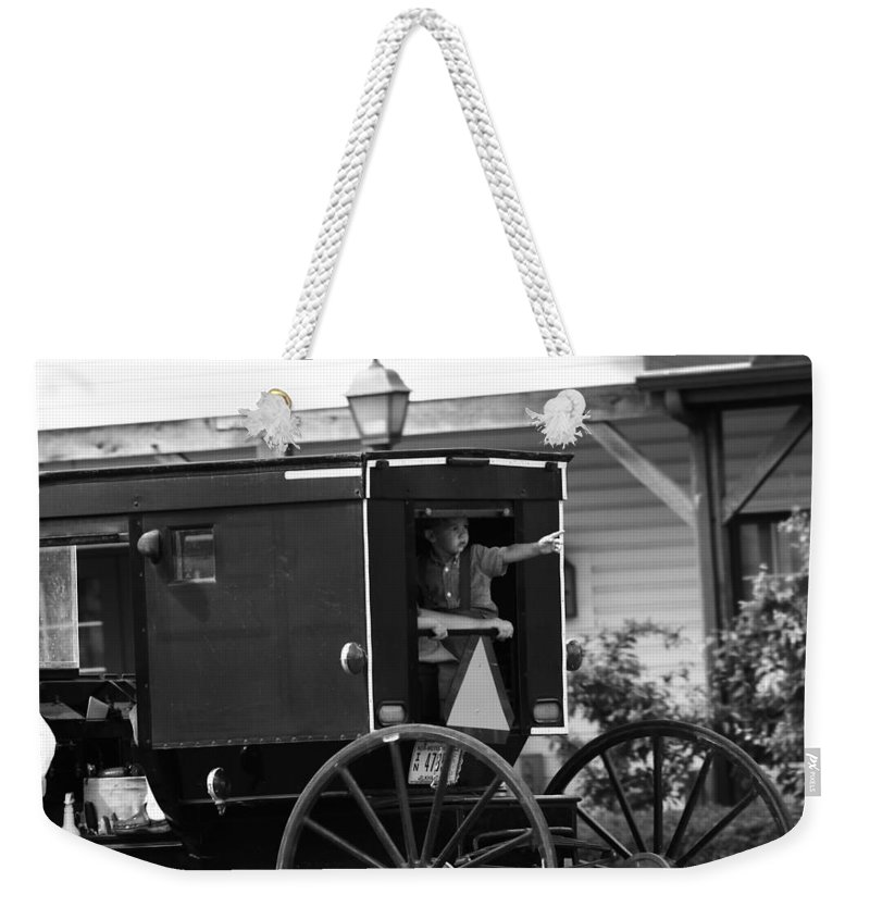 Amish Boy Waving In Horse And Buggy Weekender Tote Bag featuring the photograph Amish Boy Waving In Horse And Buggy by Dan Sproul