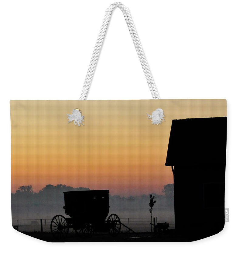 Amish Buggy Weekender Tote Bag featuring the photograph Amish Buggy Before Dawn by David Arment