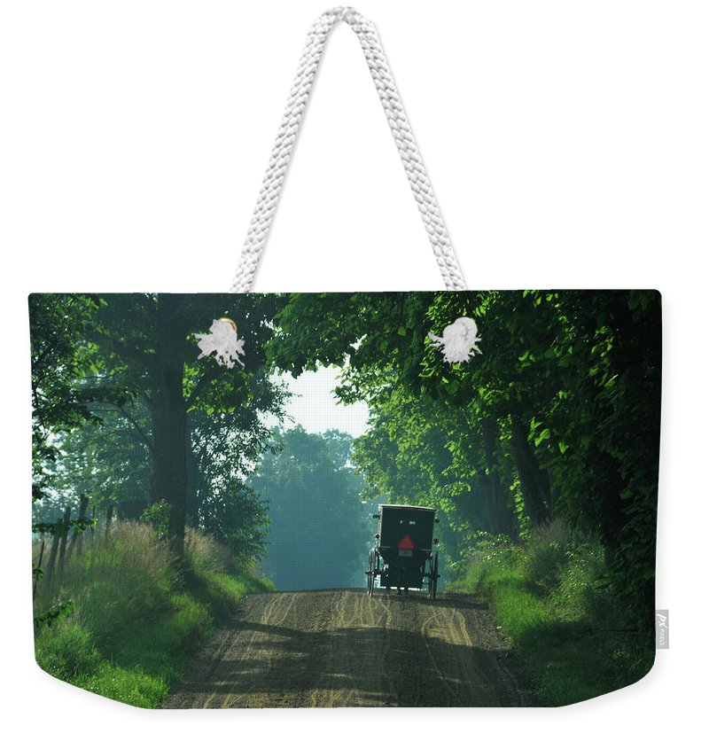 Amish Weekender Tote Bag featuring the photograph Amish Buggy Gravel Road by David Arment