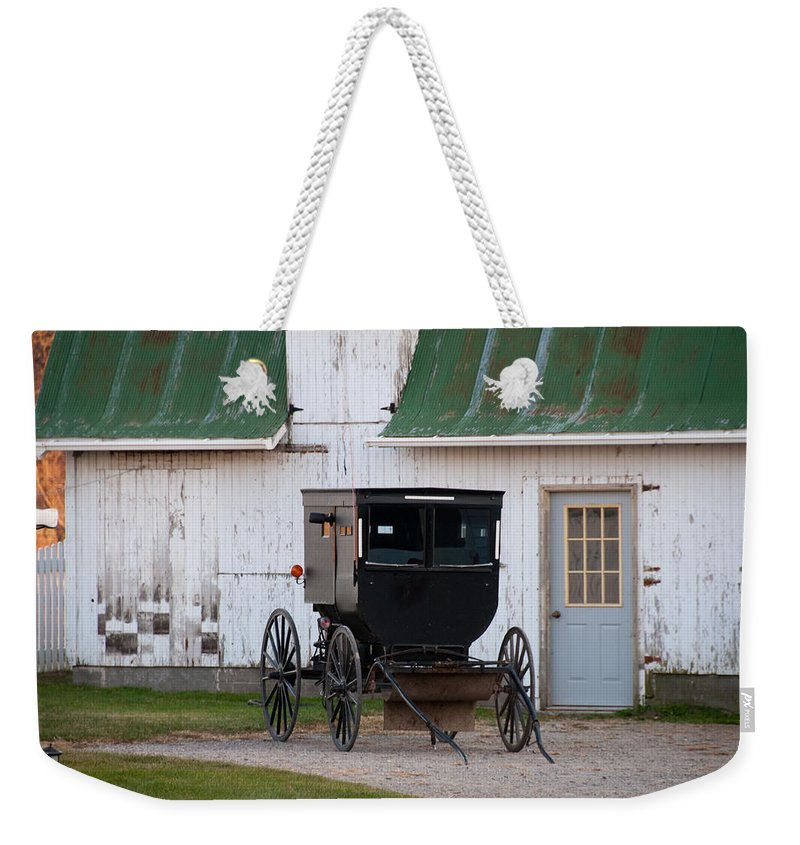 Amish Buggy Weekender Tote Bag featuring the photograph Amish Buggy White Barn by David Arment