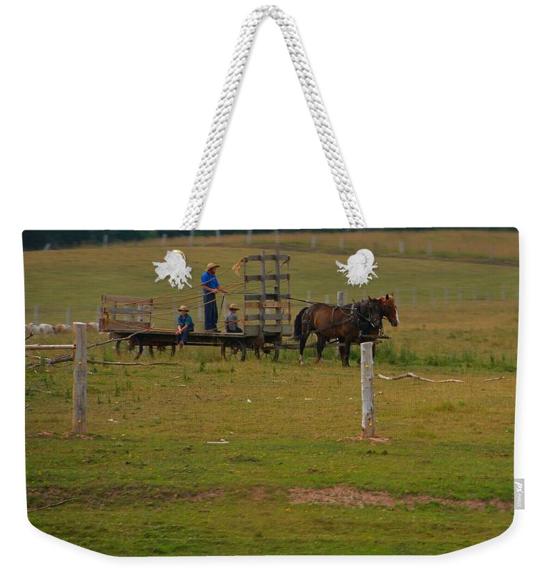 Amish Man And Two Sons On The Farm Weekender Tote Bag featuring the photograph Amish Man And Two Sons On The Farm by Dan Sproul