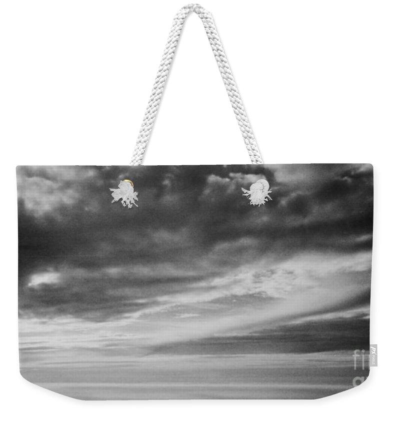 Among The Clouds Ii Weekender Tote Bag featuring the photograph Among The Clouds II by Anita Lewis