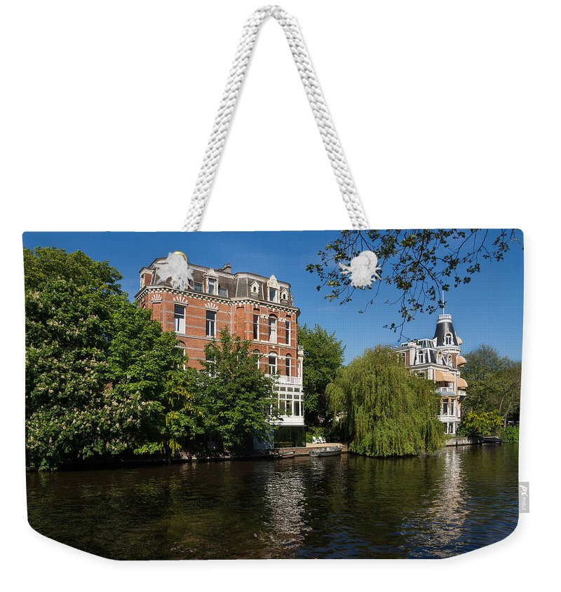 Floating By Weekender Tote Bag featuring the photograph Amsterdam Canal Mansions - Floating By by Georgia Mizuleva