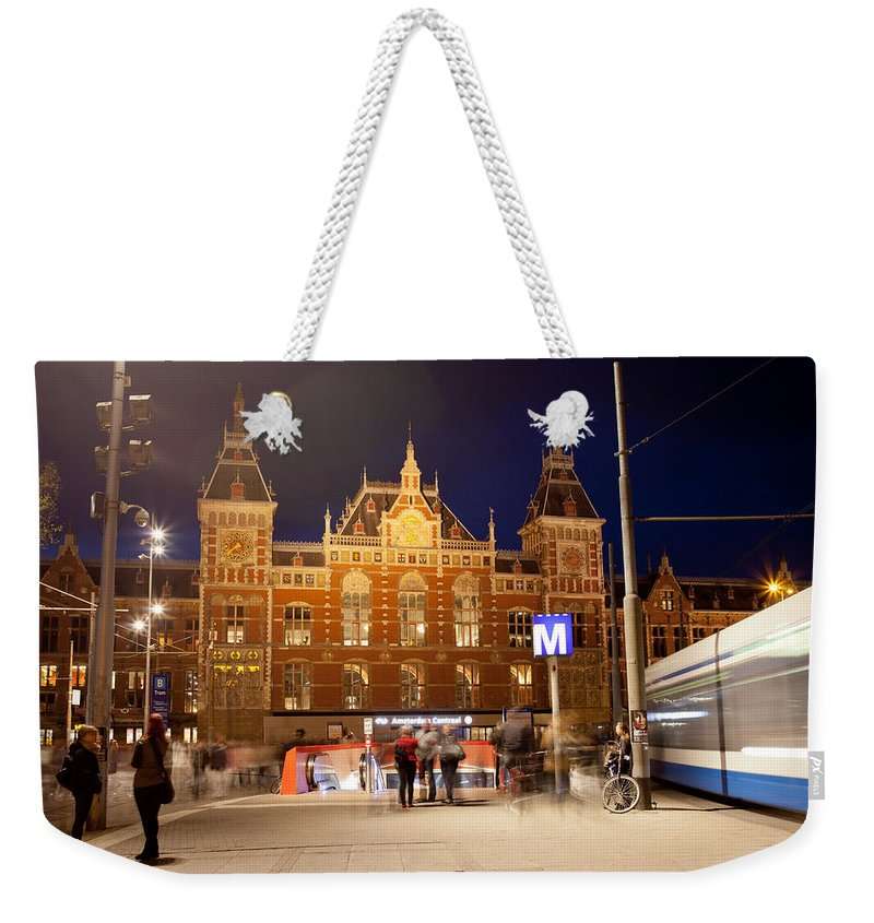 Central Weekender Tote Bag featuring the photograph Amsterdam Central Station And Metro Entrance by Artur Bogacki