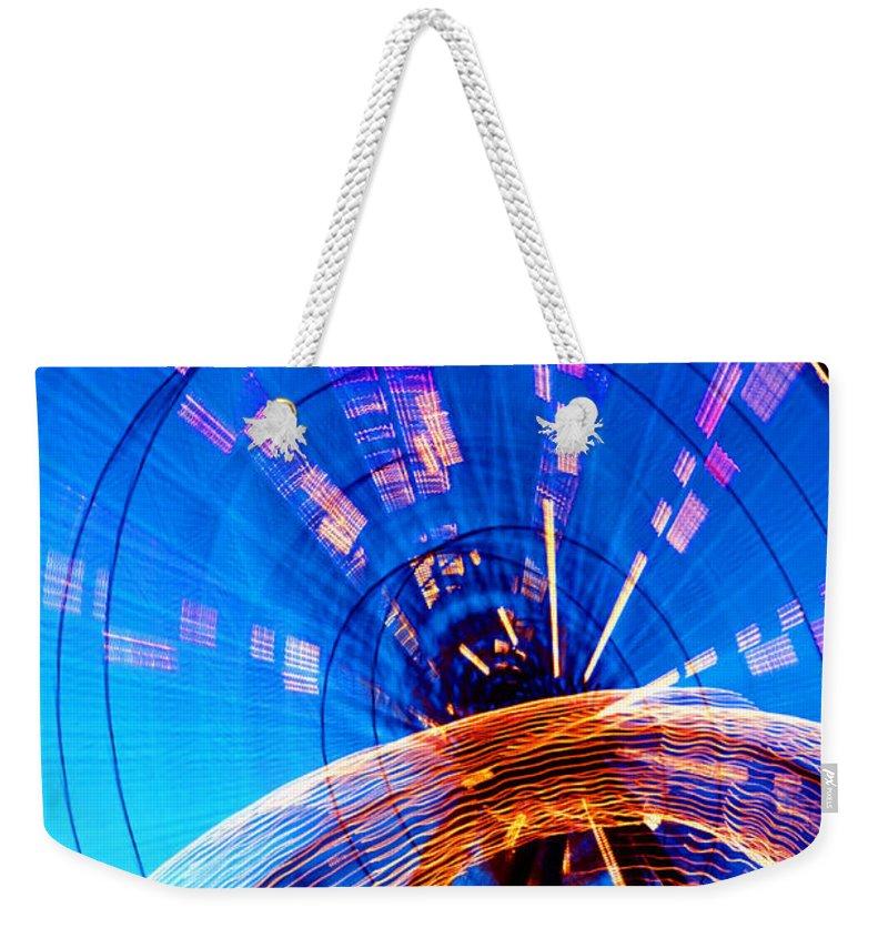 Amusement Park Weekender Tote Bag featuring the photograph Amusement Park Rides 1 by Steve Ohlsen