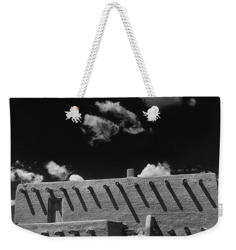 Exterior Weekender Tote Bag featuring the photograph An Adobe House by Herbert Matter