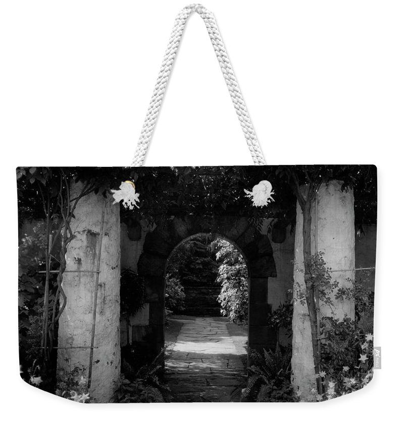 Exterior Weekender Tote Bag featuring the photograph An Archway In The Garden Of Mrs. Carl Tucker by Harry G. Healy