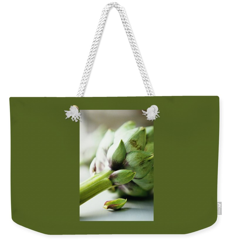 Fruits Weekender Tote Bag featuring the photograph An Artichoke by Romulo Yanes
