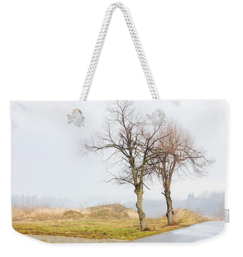 Solitude Weekender Tote Bag featuring the photograph An Empty Path by Pati Photography